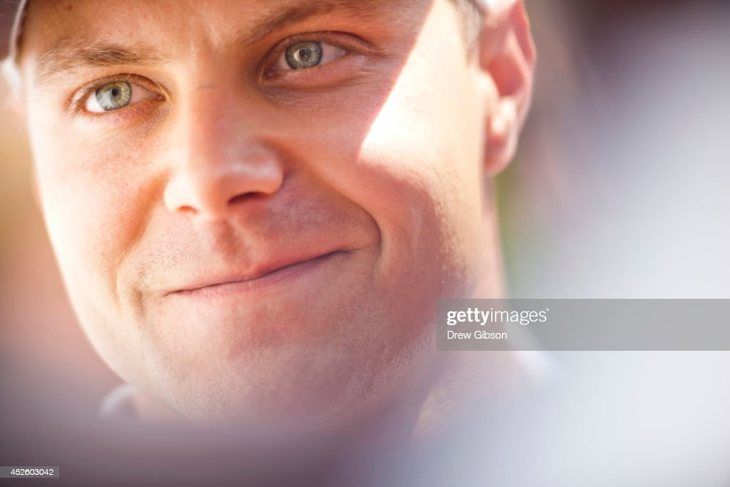 <a gi-track='captionPersonalityLinkClicked' href=/galleries/search?phrase=Valtteri+Bottas&family=editorial&specificpeople=8640136 ng-click='$event.stopPropagation()'>Valtteri Bottas</a> of Finland and Williams speaks with members of the media during previews ahead of the Hungarian Formula One Grand Prix at Hungaroring on July 24, 2014 in Budapest, Hungary.