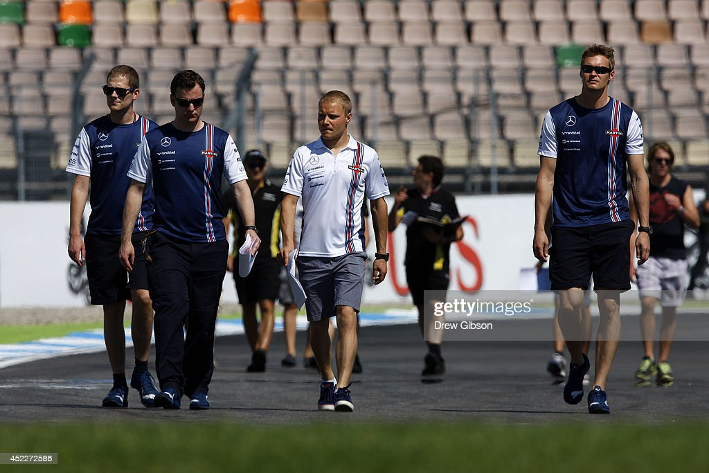 Valtteri Bottas of Finland and Williams walks around the track with members of his team during previews ahead of the German Grand Prix at Hockenheimring on July 17, 2014 in Hockenheim, Germany.