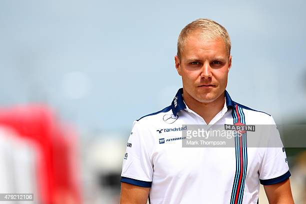 Valtteri Bottas of Finland and Williams walks through the paddock during previews to the Formula One Grand Prix of Great Britain at Silverstone...