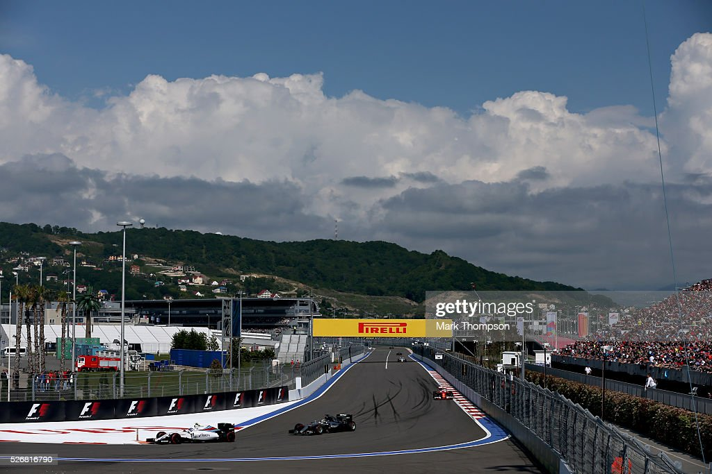<a gi-track='captionPersonalityLinkClicked' href=/galleries/search?phrase=Valtteri+Bottas&family=editorial&specificpeople=8640136 ng-click='$event.stopPropagation()'>Valtteri Bottas</a> of Finland driving the (77) Williams Martini Racing Williams FW38 Mercedes PU106C Hybrid turbo ahead of <a gi-track='captionPersonalityLinkClicked' href=/galleries/search?phrase=Lewis+Hamilton&family=editorial&specificpeople=586983 ng-click='$event.stopPropagation()'>Lewis Hamilton</a> of Great Britain driving the (44) Mercedes AMG Petronas F1 Team Mercedes F1 WO7 Mercedes PU106C Hybrid turbo and <a gi-track='captionPersonalityLinkClicked' href=/galleries/search?phrase=Kimi+Raikkonen&family=editorial&specificpeople=201904 ng-click='$event.stopPropagation()'>Kimi Raikkonen</a> of Finland driving the (7) Scuderia Ferrari SF16-H Ferrari 059/5 turbo (Shell GP) on track during the Formula One Grand Prix of Russia at Sochi Autodrom on May 1, 2016 in Sochi, Russia.
