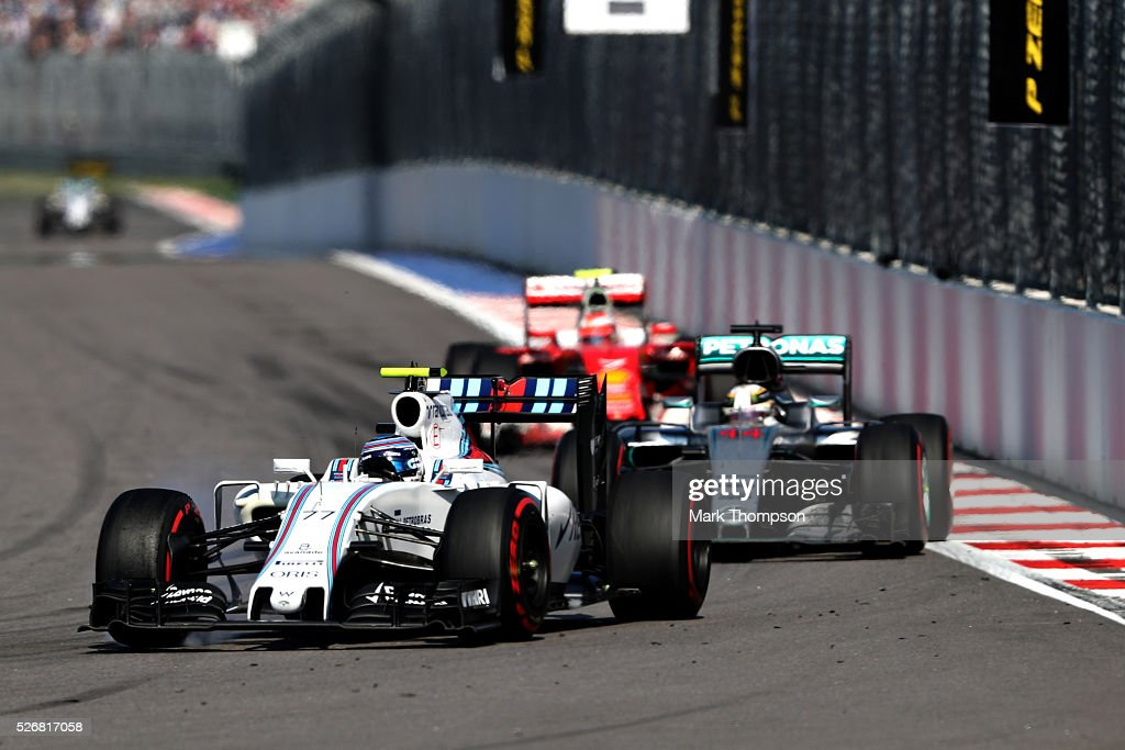 <a gi-track='captionPersonalityLinkClicked' href=/galleries/search?phrase=Valtteri+Bottas&family=editorial&specificpeople=8640136 ng-click='$event.stopPropagation()'>Valtteri Bottas</a> of Finland driving the (77) Williams Martini Racing Williams FW38 Mercedes PU106C Hybrid turbo on track ahead of <a gi-track='captionPersonalityLinkClicked' href=/galleries/search?phrase=Lewis+Hamilton&family=editorial&specificpeople=586983 ng-click='$event.stopPropagation()'>Lewis Hamilton</a> of Great Britain driving the (44) Mercedes AMG Petronas F1 Team Mercedes F1 WO7 Mercedes PU106C Hybrid turbo and <a gi-track='captionPersonalityLinkClicked' href=/galleries/search?phrase=Kimi+Raikkonen&family=editorial&specificpeople=201904 ng-click='$event.stopPropagation()'>Kimi Raikkonen</a> of Finland driving the (7) Scuderia Ferrari SF16-H Ferrari 059/5 turbo (Shell GP) during the Formula One Grand Prix of Russia at Sochi Autodrom on May 1, 2016 in Sochi, Russia.