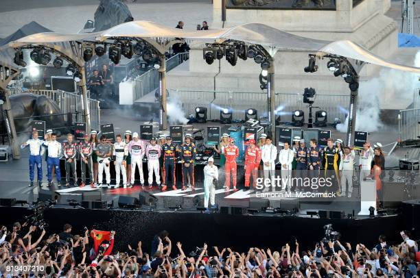Valtteri Bottas sprays champagne on stage with drivers at the F1 Live in London event at Trafalgar Square on July 12 2017 in London England F1 Live...