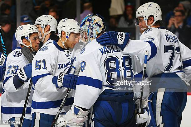 Valtteri Filppula and Andrei Vasilevskiy of the Tampa Bay Lightning celebrate after defeating the New York Islanders 40 at the Barclays Center on...