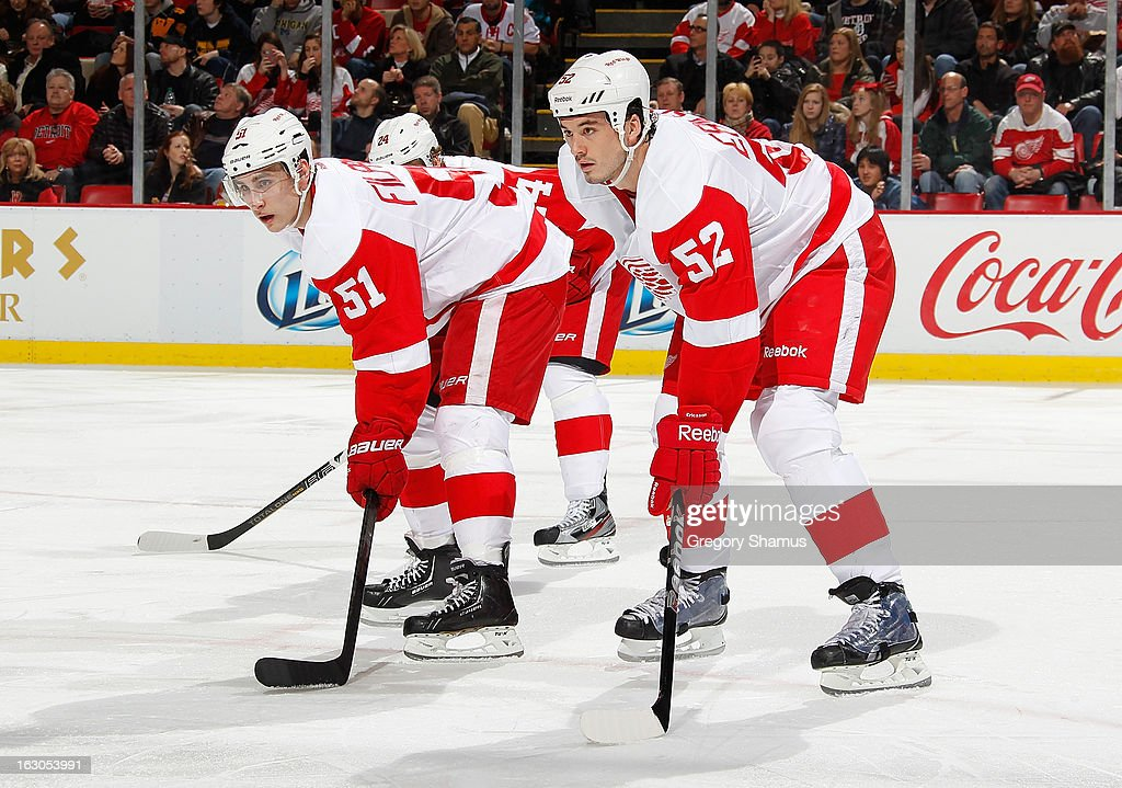 Valtteri Filppula #51 and Jonathan Ericsson #52 of the Detroit Red Wings wait for the faceoff against the Nashville Predators at Joe Louis Arena on February 23, 2013 in Detroit, Michigan. Detroit won the game 4-0.