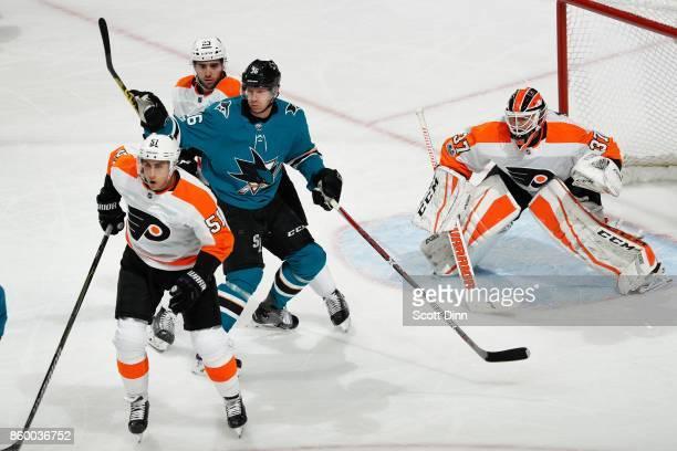 Valtteri Filppula Brandon Manning and Brian Elliot of the Philadelphia Flyers defend the net against Jannik Hansen of the San Jose Sharks during a...