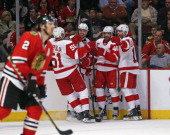 Valtteri Filppula Brendan Smith Henrik Zetterberg and Daniel Cleary of the Detroit Red Wings celebrate a second period goal as Duncan Keith of the...