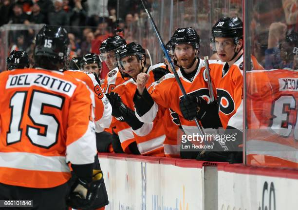 Valtteri Filppula Claude Giroux and Brayden Schenn of the Philadelphia Flyers celebrate a second period goal with teammates on the bench against the...