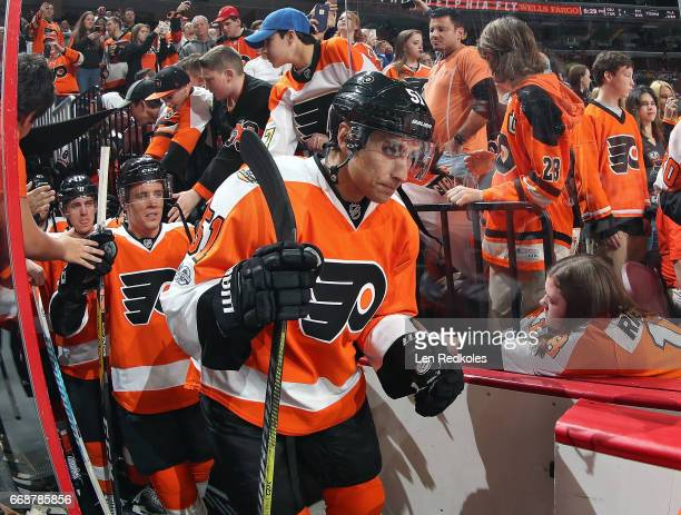 Valtteri Filppula Nick Cousins and Travis Konecny of the Philadelphia Flyers enter the ice surface for warmups against the Carolina Hurricanes on...