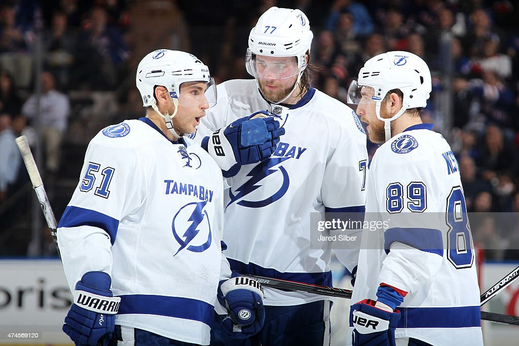 Valtteri Filppula Nikita Nesterov and Victor Hedman of the Tampa Bay Lightning talk during a break in the action against the New York Rangers in Game...
