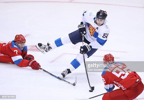 Valtteri Filppula of Team Finland shoots as he falls to the ice against Team Russia during the World Cup of Hockey tournament at the Air Canada...
