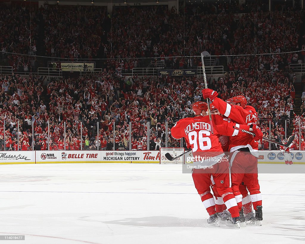 Valtteri Filppula #51 of the Detroit Red Wings celebrates his game winning goal with teammates during Game Six of the Western Conference Semifinals of the 2011 NHL Stanley Cup Playoffs against the San Jose Sharks at Joe Louis Arena on May 10, 2011 in Detroit, Michigan. The Detroit Red Wings defeated the San Jose Sharks 3-1.
