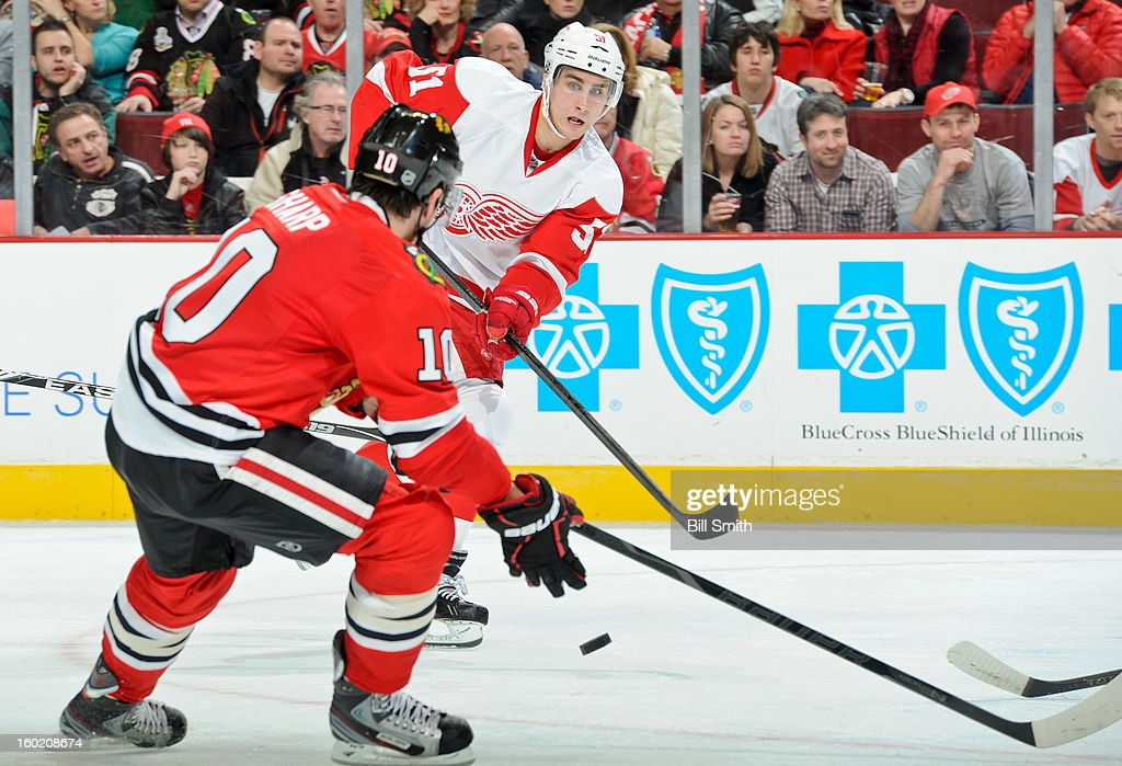 Valtteri Filppula #51 of the Detroit Red Wings passes the puck across the ice during the NHL game against the Chicago Blackhawks on January 27, 2013 at the United Center in Chicago, Illinois.