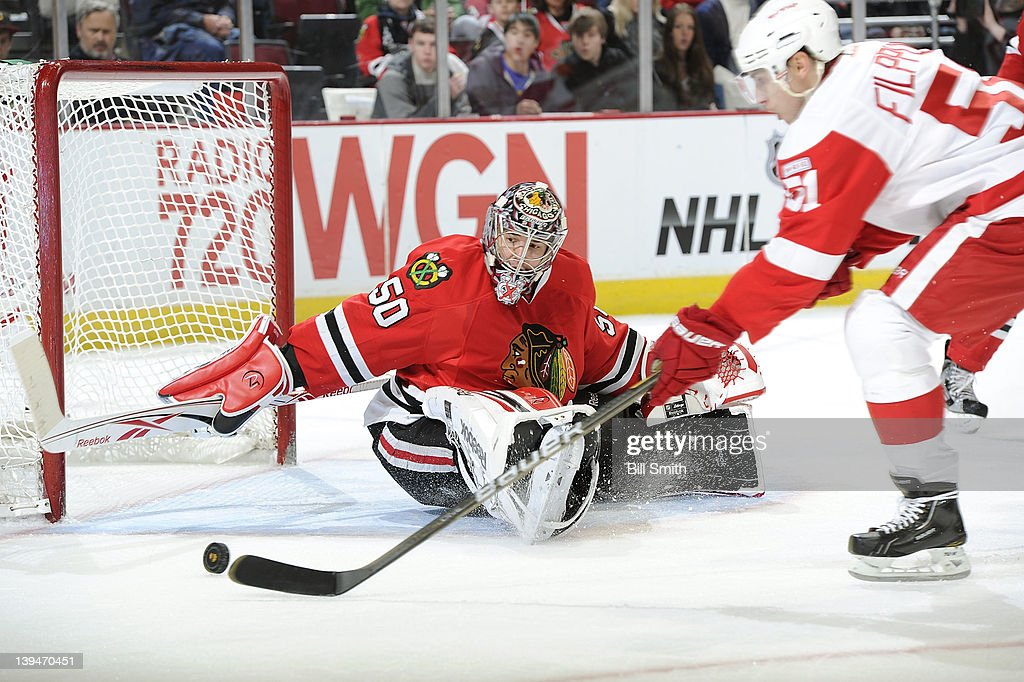 Valtteri Filppula of the Detroit Red Wings takes the puck toward goalie Corey Crawford of the Chicago Blackhawks during the NHL game on February 21...