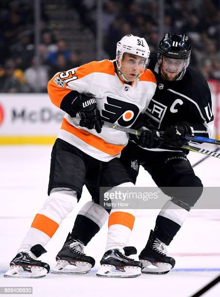 Valtteri Filppula of the Philadelphia Flyers and Anze Kopitar of the Los Angeles Kings bump as they follow play during opening night of the Los...