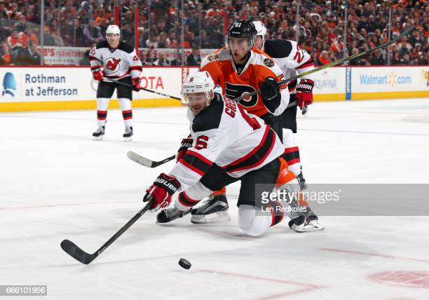 Valtteri Filppula of the Philadelphia Flyers back checks Andy Greene of the New Jersey Devils as they battle for the puck on April 1 2017 at the...