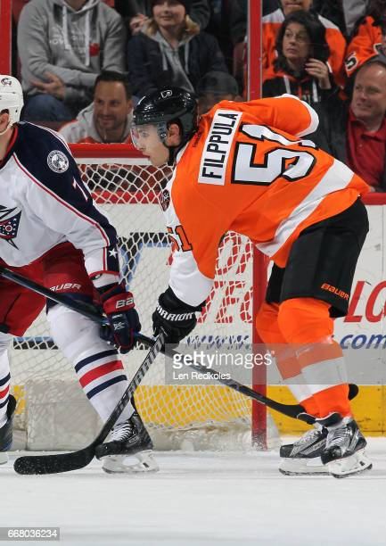 Valtteri Filppula of the Philadelphia Flyers battles against Jack Johnson of the Columbus Blue Jackets on April 8 2017 at the Wells Fargo Center in...