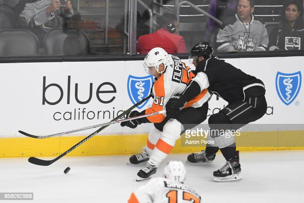 Valtteri Filppula of the Philadelphia Flyers battles for the puck during a game against the Los Angeles Kings at STAPLES Center on October 05 2017 in...