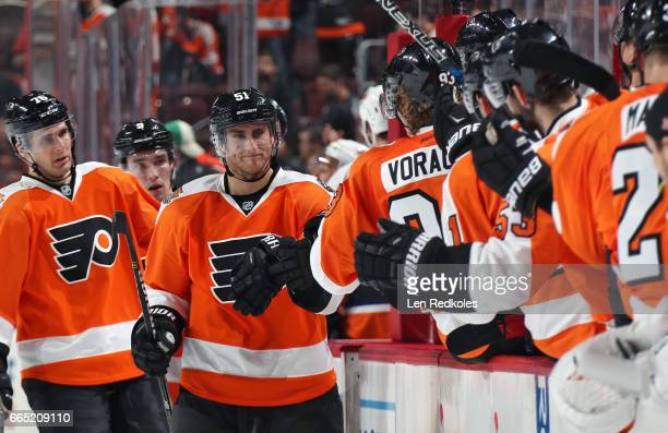 Valtteri Filppula of the Philadelphia Flyers celebrates a third period goal with teammates on the bench against the New York Islanders on March 30...