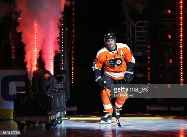 Valtteri Filppula of the Philadelphia Flyers enters the ice surface during opening night ceremonies prior to his game against the Washington Capitals...