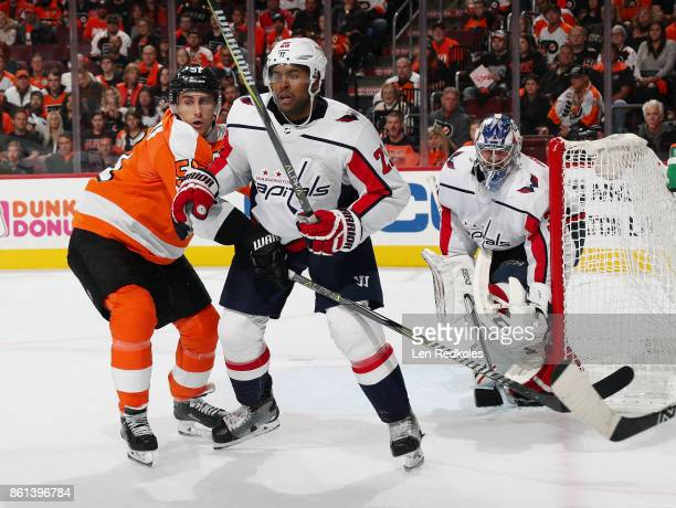 Valtteri Filppula of the Philadelphia Flyers playing in his 800th NHL game battles for position in front of goaltender Philipp Grubauer of the...