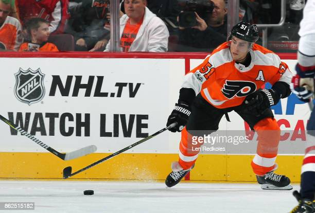 Valtteri Filppula of the Philadelphia Flyers reaches for the loose puck against the Washington Capitals on October 14 2017 at the Wells Fargo Center...