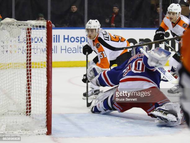 Valtteri Filppula of the Philadelphia Flyers scores during the third period against Henrik Lundqvist of the New York Rangers at Madison Square Garden...