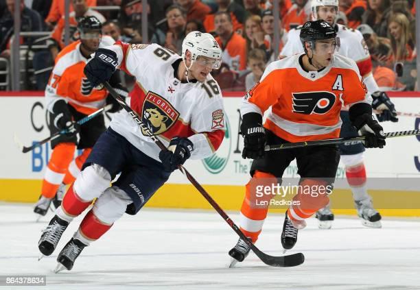 Valtteri Filppula of the Philadelphia Flyers skates against Aleksander Barkov of the Florida Panthers on October 17 2017 at the Wells Fargo Center in...