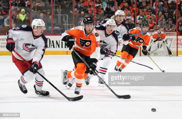 Valtteri Filppula of the Philadelphia Flyers skates the puck against Markus Nutivaara Josh Anderson and William Karlsson of the Columbus Blue Jackets...