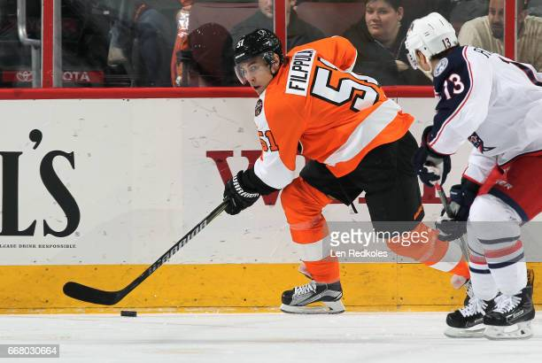 Valtteri Filppula of the Philadelphia Flyers skates the puck against Cam Atkinson of the Columbus Blue Jackets on April 8 2017 at the Wells Fargo...