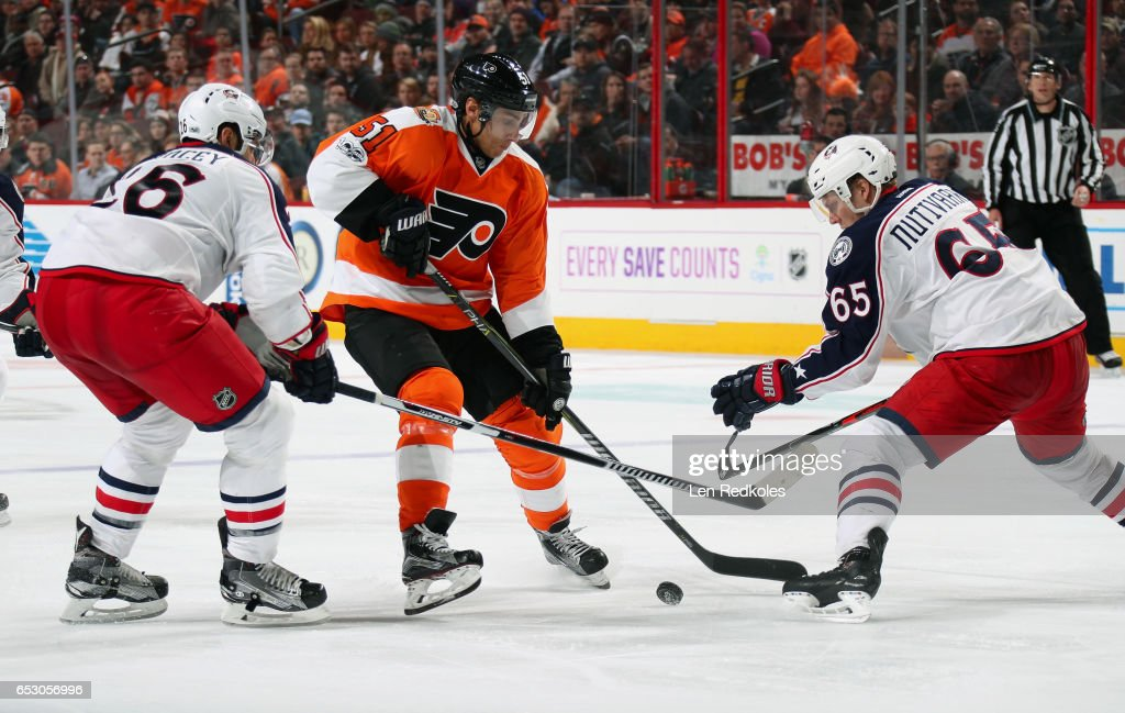 Valtteri Filppula #51 of the Philadelphia Flyers skates with the puck against Kyle Quincey #26 and Markus Nutivaara #65 of the Columbus Blue Jackets on March 13, 2017 at the Wells Fargo Center in Philadelphia, Pennsylvania. The Blue Jackets went on to defeat the Flyers 5-3.