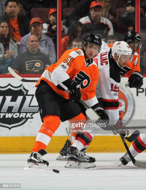 Valtteri Filppula of the Philadelphia Flyers wins control of the puck on a faceoff against Travis Zajac of the New Jersey Devils on April 1 2017 at...