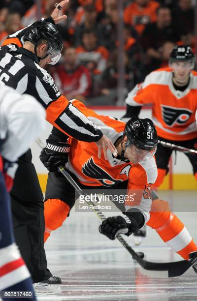 Valtteri Filppula of the Philadelphia Flyers wins control of the puck on a faceoff against the Washington Capitals on October 14 2017 at the Wells...