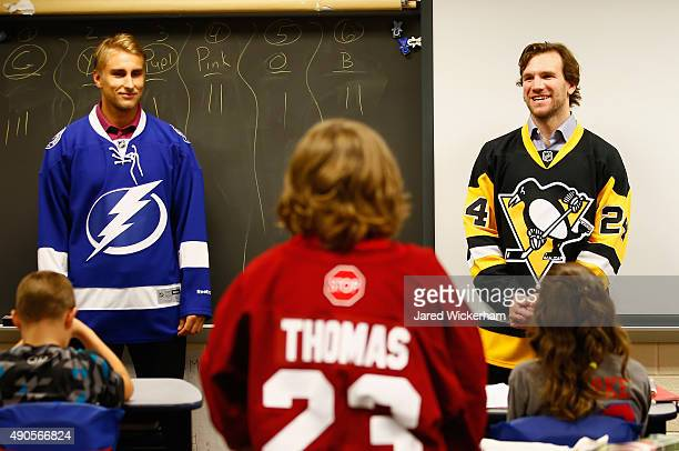 Valtteri Filppula of the Tampa Bay Lightning and Bobby Farnham of the Pittsburgh Penguins speak to the kids of Richland Elementary School before the...