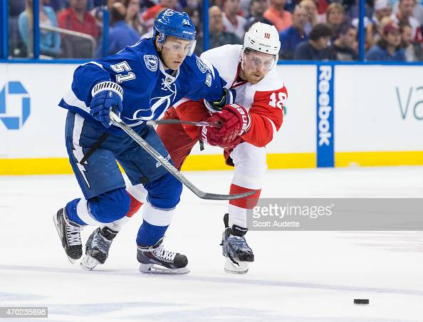 Valtteri Filppula of the Tampa Bay Lightning battles for the puck against Joakim Andersson of the Detroit Red Wings during the first period in Game...