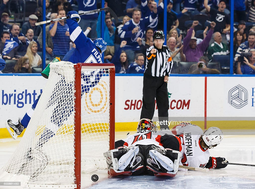 Valtteri Filppula #51 of the Tampa Bay Lightning celebrates his goal against goalie Craig Anderson #41 and Mike Hoffman #68 of the Ottawa Senators during third period at the Amalie Arena on December 10, 2015 in Tampa, Florida.