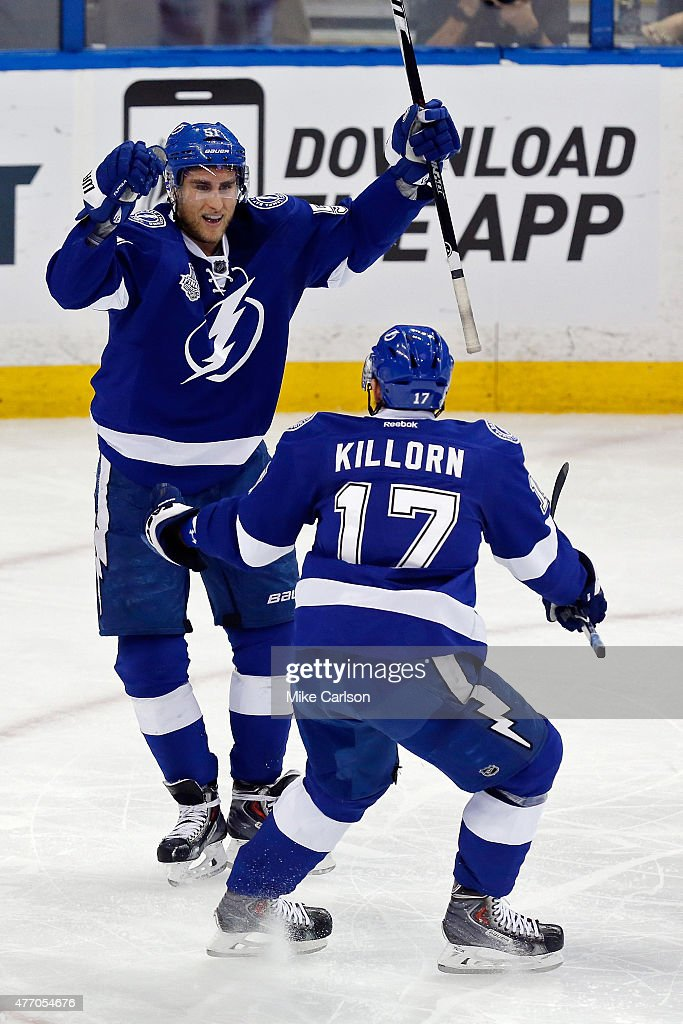 Valtteri Filppula of the Tampa Bay Lightning celebrates with Alex Killorn after scoring a second period goal against Corey Crawford of the Chicago...