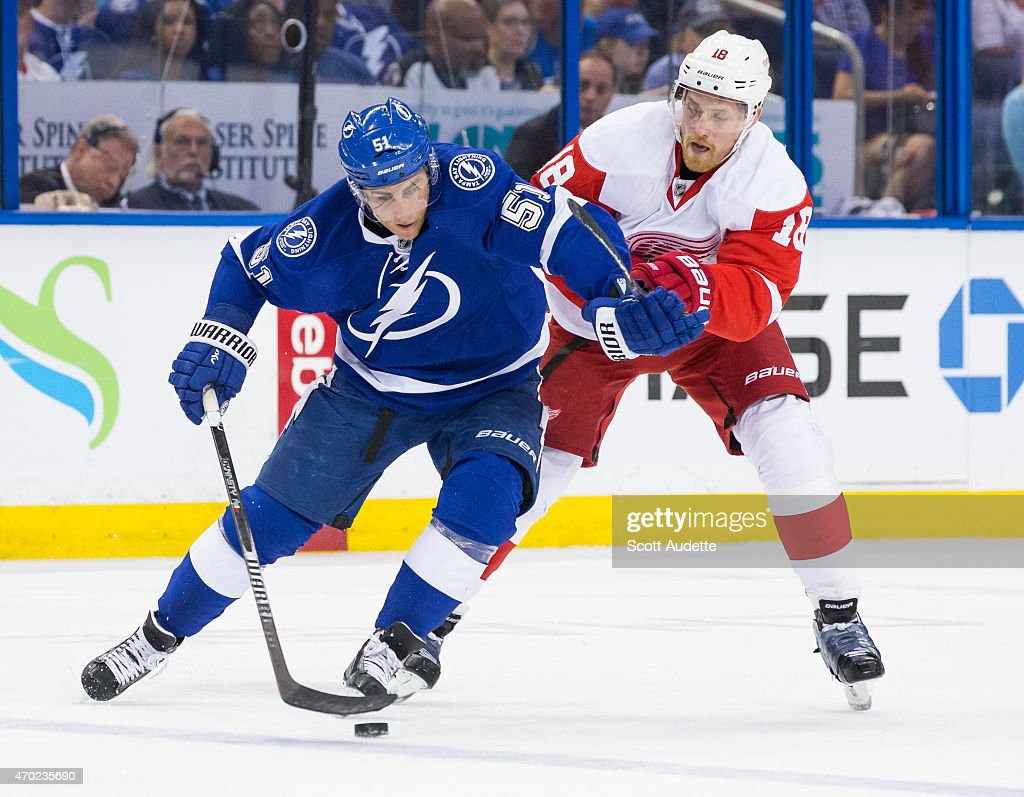 Valtteri Filppula of the Tampa Bay Lightning controls the puck against Joakim Andersson of the Detroit Red Wings during the first period in Game Two...