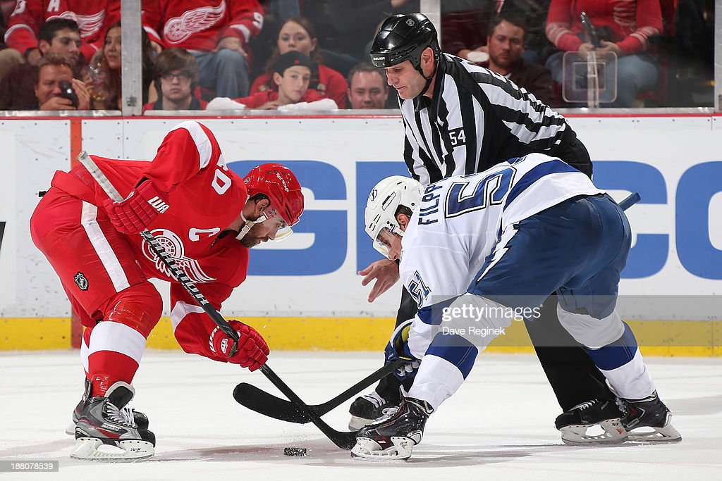 Valtteri Filppula #51 of the Tampa Bay Lightning faces off against Henrik Zetterberg #40 of the Detroit Red Wings during an NHL game at Joe Louis Arena on November 9, 2013 in Detroit, Michigan. Tampa Bay defeated Detroit 3-2 in overtime.