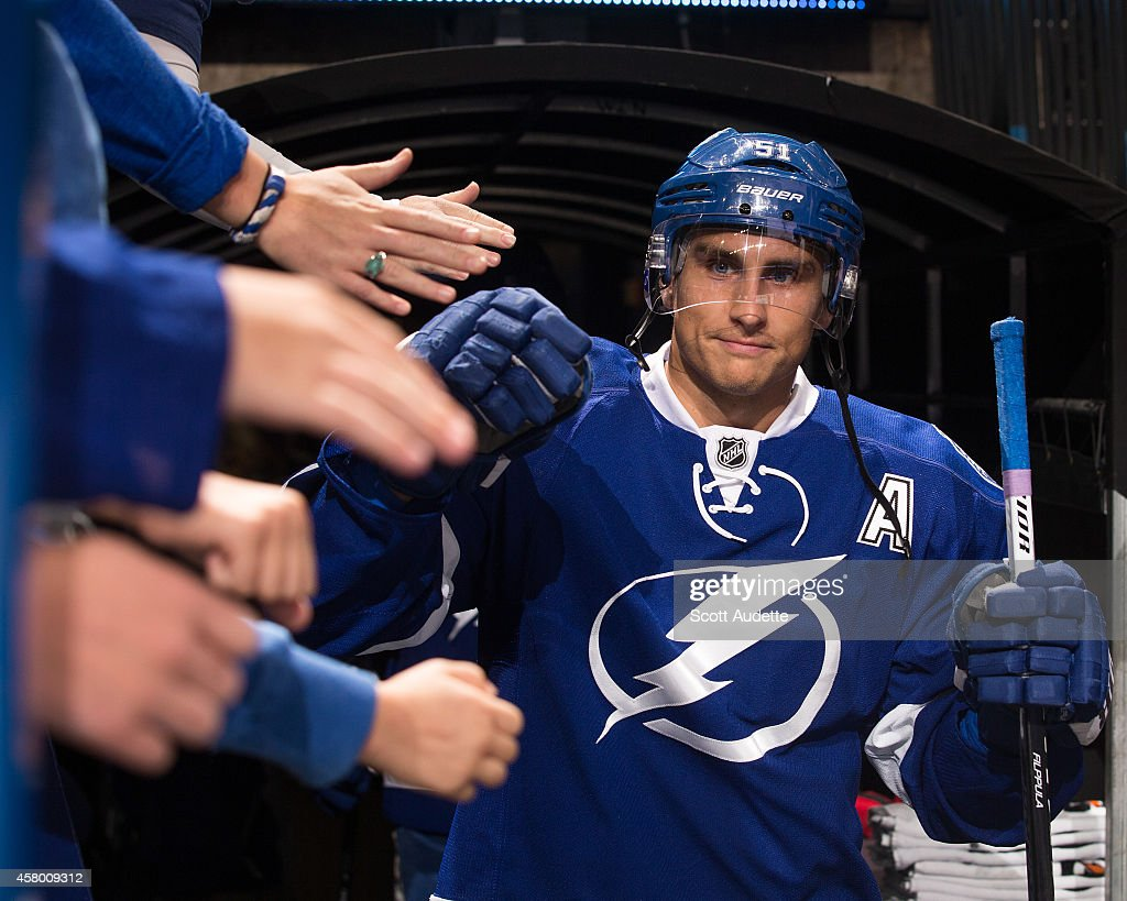 Valtteri Filppula of the Tampa Bay Lightning is greeted by fans as he walks out to the ice for pre game warmups prior to the game against the Arizona...