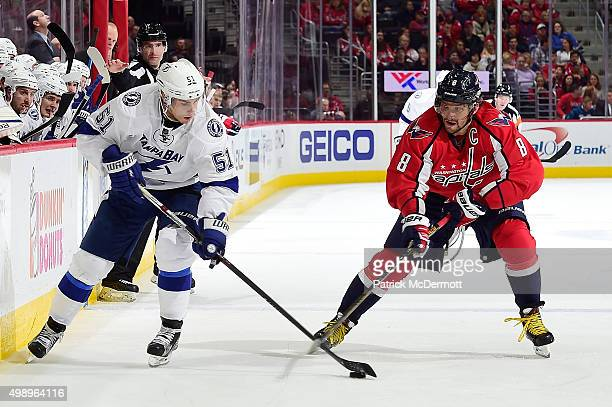 Valtteri Filppula of the Tampa Bay Lightning moves the puck up ice against Alex Ovechkin of the Washington Capitals in the second period during an...