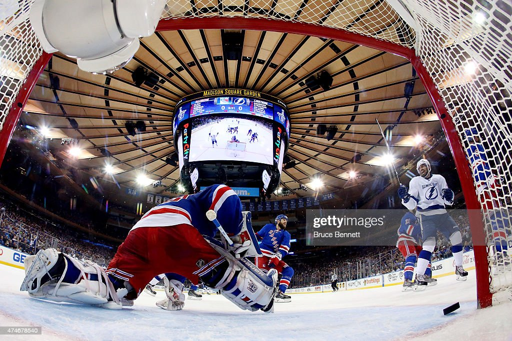 Valtteri Filppula of the Tampa Bay Lightning scores a goal against Henrik Lundqvist of the New York Rangers during the second period in Game Five of...
