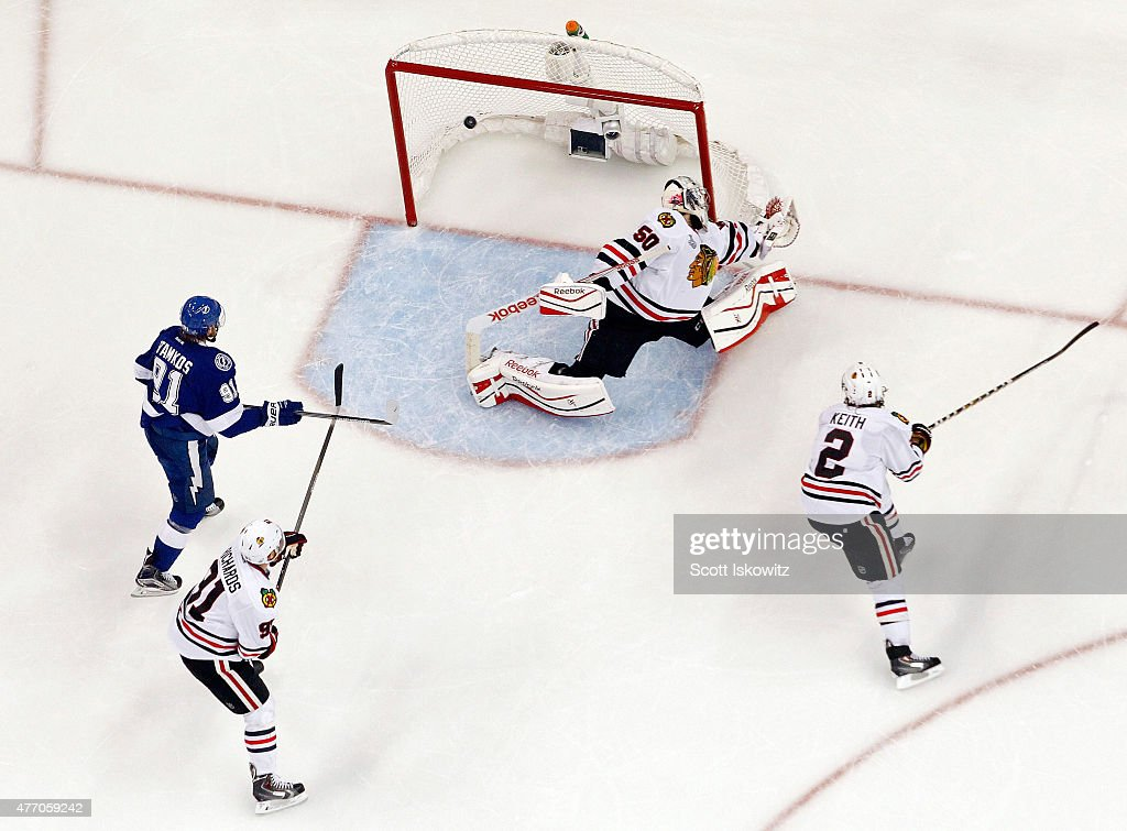 Valtteri Filppula #51 of the Tampa Bay Lightning scores a second period goal against Corey Crawford #50 of the Chicago Blackhawks during Game Five of the 2015 NHL Stanley Cup Final at Amalie Arena on June 13, 2015 in Tampa, Florida.
