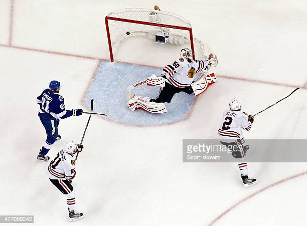 Valtteri Filppula of the Tampa Bay Lightning scores a second period goal against Corey Crawford of the Chicago Blackhawks during Game Five of the...