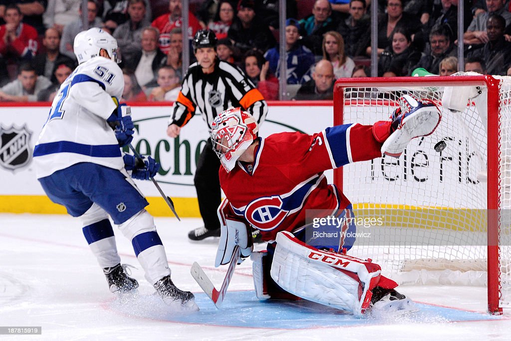 Valtteri Filppula of the Tampa Bay Lightning scores his shootout attempt on Carey Price of the Montreal Canadiens to win the game during the NHL game...