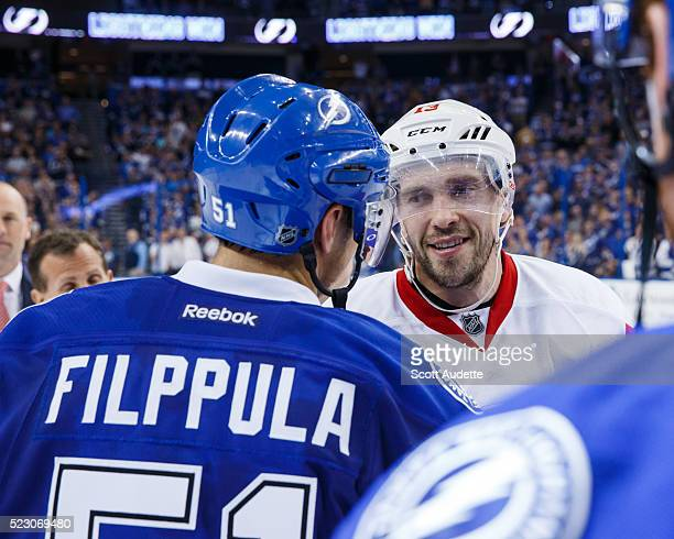 Valtteri Filppula of the Tampa Bay Lightning shakes the hand of Pavel Datsyuk of the Detroit Red Wings after the series win in Game Five of the...