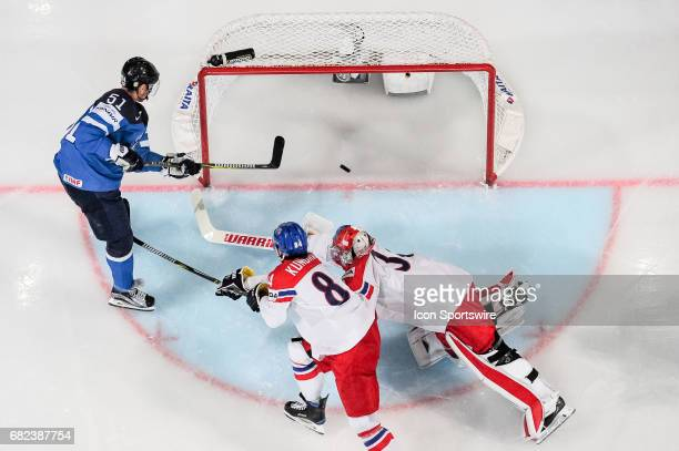 Valtteri Filppula scores a goal against Goalie Petr Mrazek and Tomas Kundratek during the Ice Hockey World Championship between Finland and Czech...