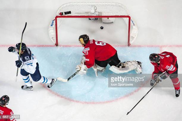 Valtteri Filppula scores a goal in the net of Goalie Leonardo Genoni during the Ice Hockey World Championship between Switzerland and Finland at...
