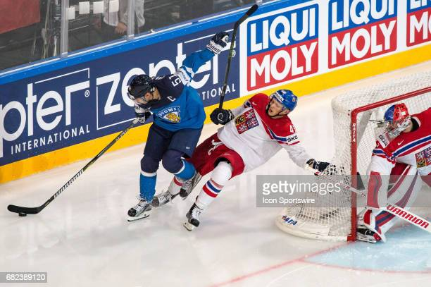 Valtteri Filppula vies with Radim Simek during the Ice Hockey World Championship between Finland and Czech Republic at AccorHotels Arena in Paris...