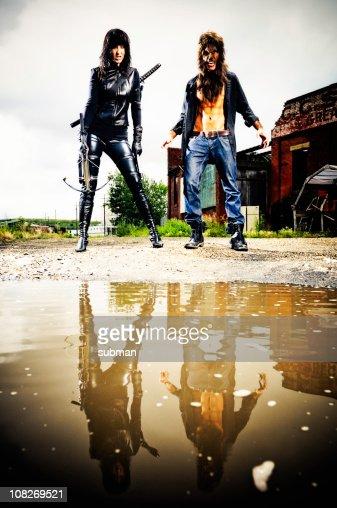 Vampire and Werewolf Costumed Men Reflected in Puddle : Bildbanksbilder