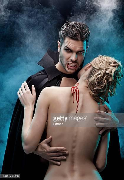 vampire holding his victim